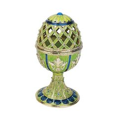 Remarkable filigree cutwork punctuated by petite, sparkling jewels attracts the eye to this museum-quality, Faberge-style egg. Carl Faberge's 17th-century creation is cast in metal alloy using the anc