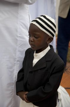 A Kenyan Muslim boy offer prayer during Eid al-Fitr at the grounds of Noor Mosque in Nairobi, Kenya, Friday, Aug. 9, 2013.  By:Sayyid Azim...