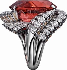 CARTIER. Ring - platinum, one 35.06-carat cushion-cut cognac tourmaline, pink garnets, brilliant-cut diamonds