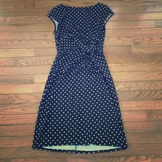 Polka dot dress Black with white polka dots. Only worn once but there is a pull in the hem as seen in the pictures. Otherwise, no other flaws. Nice riches knot at waist is very slimming. Merona Dresses Midi