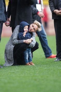Pin for Later: Princess Charlene Brings One of Her Supercute Twins to a Monaco Rugby Match