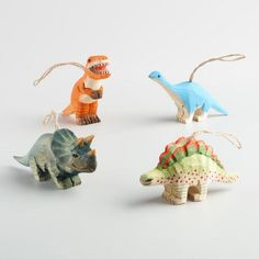 This hand-carved wood set of finely painted wooden dinosaur ornaments includes a triceratops, a stegosaurus, a brontosaurus and a T-rex.