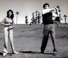 Raj Kapoor & Nargis playing golf.