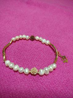 Perla de rio y chapa de oro