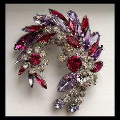 Sherman brooch stunning rare colours , alexandrite , fuchsia, clear and purple. Rhodium plated .