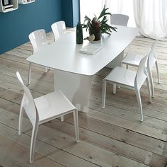 Shop Italian contemporary furniture from top manufacturers like Domitalia and Kubikoff offering fine italian-made convertible sofas, extension tables, dining chairs, and lounge seating. White Laminate, Rectangle Table, Outdoor Tables, Outdoor Dining, Dining Room Inspiration, Stackable Chairs, Lounge Seating, Dining Table Chairs, Dining Rooms