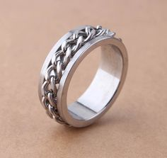 Find More Rings Information about 8MM Width Silver Color Wholesale Rings 316L Stainless Steel Finger Rings With SPIN CHAIN us size 7 13,High Quality steel retaining rings,China ring disco Suppliers, Cheap ring light from Chinese Jewelry Factory,Wholesale From Yiwu China on Aliexpress.com
