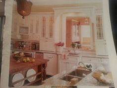 Love how the kitchen has a window into the dining room
