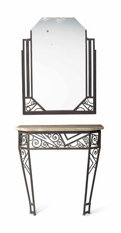 A French Art Deco wrought iron console table and mirror, circa 1930.