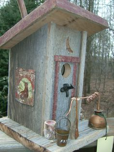 Outhouse Birdhouse with moonshine still