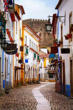 Gorgeous Obidos, Portugal, You can buy chocolate cups of ginga liqueur wherever you go!