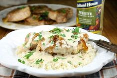 Incredibly delicious Slow Cooker Smothered Pork Chops with Sour Cream Gravy Recipe is a family favorite dinner made so easily in the crock pot! Slow Cooker Pork, Slow Cooker Recipes, Crockpot Recipes, Freezer Recipes, Crockpot Dishes, Cooking Wine Recipes, Cooking Pork, Easy Cooking, Cream Gravy