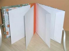 Envelope Book-Tutorial by Jaine Drake-To create a basic envelope book you will need: 4 envelopes all the same size 2 pieces of plain cardstock cut to the same size as the envelopes Patterned scrapbook papers to cover the card...A piece of card stock as wide as the envelopes and 12 inches long...A length of ribbon