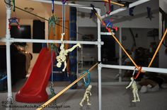 Zipline for your action figures - made of pvc pipes, bunjee cords, and carabiners