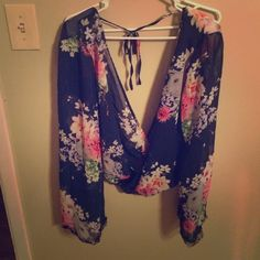 Forever 21 floral surplice top GORGEOUS surplice top. Open back and flared sleeves. Only been worn twice! In great condition. Forever 21 Tops Blouses
