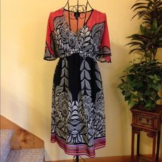 Beautiful MOSSIMO Dress-attached black slip liner Red, black, grey sheer dress with black slip liner. Hem has orange, purple, red, grey stripes. Butterfly sleeves. Elastic under bust and around back waist. Length 36 1/2 on Manequin. 100% polyester. Mossimo Supply Co Dresses