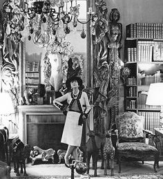 Coco Chanel in front of the fire place in her Paris apartment