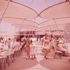 Tomorrowland - Disneyland USA - 1955...what I wouldn't give for the shade covers and the eames fiberglass chairs and tables