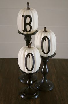 Halloween pumpkins - BOO! I'm thinking you could also have regular unpainted pumpkins and find 4 tiers that could spell FALL for Thanksgiving :-)