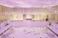 WedLuxe: We love the pretty pink uplighting and monogrammed dance floor at this stunning Toronto #wedding #reception