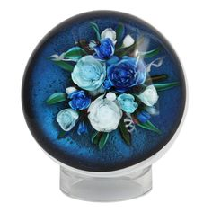 "2011  A fine Rick Ayotte bouquet paperweight titled ""Midnight Blue"" on a blue dicroic glass ground"