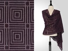 This bold lattice design, simply realized in double crochet and chain stitch, stands out in this plummy purple color.