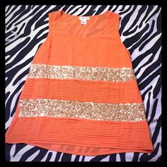 Orange and gold tank top This is an orange tank top with gold sequins. There is a little spot where there are no sequins but not noticeable when worn Tops Tank Tops