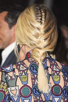 Separate a two-by-four-inch section on the back of the head and create a tight french braid and secure with an elastic at the base. Make a center part at the front of hair and loosely French braid the remaining hair and secure with another elastic.