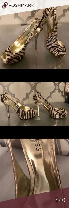 Guess heels Worn  only twice before I hurt my back. Doc says no heels.😣 2 inch golf and black sequined zebra printed high heels. Size 8 and super cute on! The perfect heel to rock a great weekend outfit this spring and summer! Guess Shoes Heels