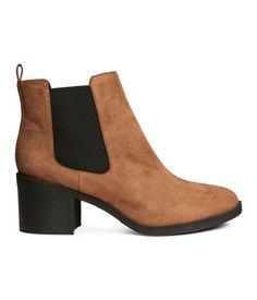 Chelsea-style boots in imitation suede with elastic panels at sides. Rubber soles. Heel height 2 1/2 in.