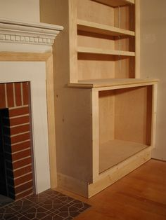 Fireplace with Bookcases On Sides | ... side shelf. Some of the moulding of the fireplace had to be replaced