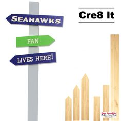 """this SEAHAWKS-THEMED DIRECTIONAL SIGN by painting our unfinished boards with blue, green & grey paint and apply our """"Seahawks Fan Lives Here!"""" self-adhesive vinyl quote to the boards! Seahawks Fans, Directional Signs, Vinyl Quotes, Grey Paint, Frame Shop, Adhesive Vinyl, Wedding Signs, Green And Grey, Holiday Ideas"""