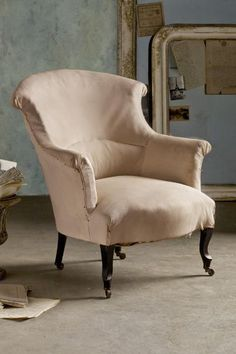 Our antique Rouleau Scroll Backs Chair is circa 1890 and has white muslin upholstery. A hardwood frame and castors on all legs mean this piece is easy to move around if you prefer a versatile seating option.