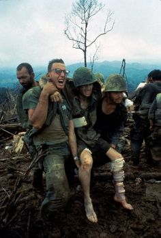 Larry Burrows. American Marines aid wounded comrades during Operation Prairie near the DMZ during the Vietnam War, October 1966.