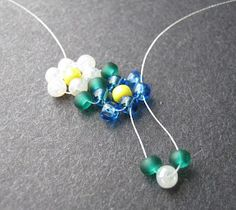 To get a traditional looking daisy chain, use a basic palette of opaque seed beads, or better yet, love beads. To get the hang of this stitch, it can Seed Bead Patterns, Beading Patterns Free, Beading Tutorials, Beaded Jewelry Designs, Bead Jewellery, Daisy Bracelet, Bead Loom Bracelets, Daisy Chain, Beads And Wire