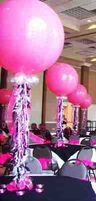 Single balloon centerpiece but in wedding colors