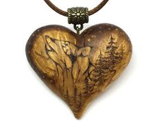 I'm loving this one! - Howling Wolf Heart Pendant.