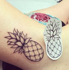Size and style of pineapple tattoo. Black and white. Left lower calf