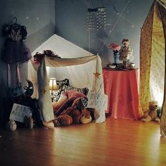 Picture only. Dreamy DIY sheet forts for kids! inspiration for family indoor camping / glamping or for kids sleepover tents in the living room. This would also be a cute reading / privacy nook in their bedroom! I love the string lights, gold stars and comfy pillows and blankets and stuffed animals! Give them a box of decorations and let the kids decorate it however they like!