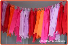 DIY party decorations using crepe paper. A gorgeous custom banner for your party!