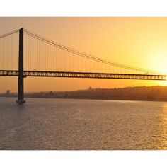 Sunset Bridge Wall Mural: Architecture: Landmarks: San Francisco's Golden Gate bridge stand high above the water, while the golden sun sets in the distance showering the bridge and water with a shimmering glow. Any wall mural image you choose can be printed on demand. Your specifications will be met for any interior design or home decor project. Create your own wallpapers, wall art and more by exploring our extensive image collection which includes cityscapes, buildings, landmarks and…