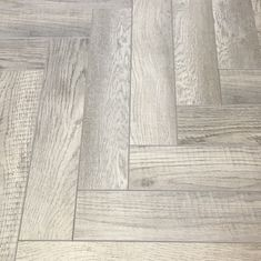 Grey Herringbone Laminate parquet floor with natural knots and variants in tone throughout each board from Floor Monster. Herringbone Laminate Flooring, Engineered Hardwood Flooring, Parquet Flooring, Grey Flooring, Wood Laminate, Kitchen Flooring, Hardwood Floors, Best Flooring, Flooring Types
