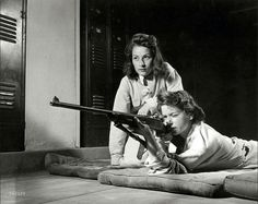Girl practicing target shooting at Roosevelt H.S. in Los Angeles, 1942