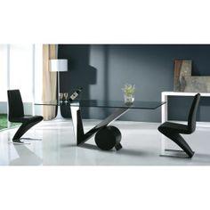 Las sillas en forma de Z invertida son bastante cómodas, modernas y sobrias. La mesa viene con vidrio transparente bicelado y una base en acero y cromo superbrillante en forma de V y un cilindro negro que horizontalmente ofrece un gran contraste.