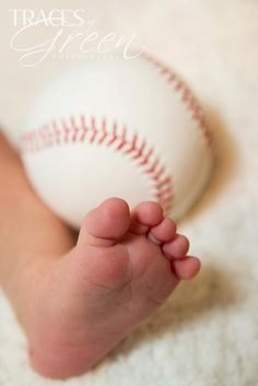 Tips for a Successful Newborn Photo Shoot.. like the softball and hockey idea for props :)