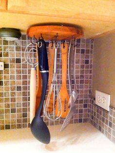 DIY rotating cooking utensil storage rack made from a lazy susan mechanism.