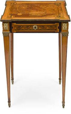 A Louis XVI style gilt bronze mounted marquetry inlaid mahogany and thuyawood table a ecrire fourth quarter 19th century