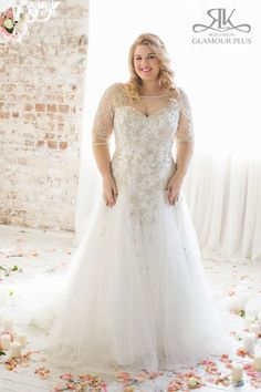 Sleeved Wedding Dress with illusion neckline. Beaded dress with deep v back and tule godet skirt. Dress by Roz la Kelin, Glamour Plus Collection Style: Acacia Fabrics: Embroidered tulle/Satin/Beading #rozlakelin #curvy #glamourplus