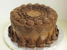 - My first cake after taking Kathleen Lange's class.  I just love Lambeth style.  I hope to get better.  All chocolate buttercream.