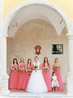 Romantic coral floor length bridesmaid dresses via Wedding Sparrow http://weddingsparrow.co.uk/2014/07/07/romantic-corals-portugal-real-wedding/
